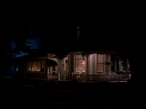 lights glow inside a victorian style home. - 19th century style stock videos and b-roll footage