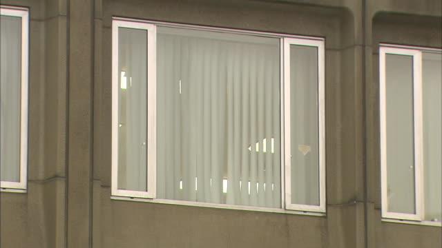 Lights glow inside a window on Hokkaido Government Office / Shot on December 5 2011