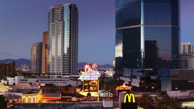 lights glowing and windows shining on las vegas hotels - drone shot - las vegas stock videos & royalty-free footage