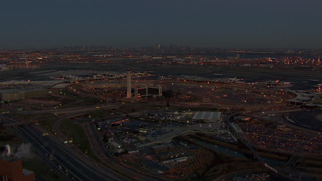 lights go on at the newark airport late in the day. - hotel stock videos & royalty-free footage