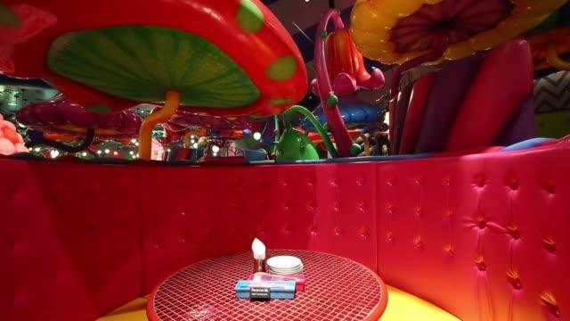 vídeos de stock, filmes e b-roll de lights hang from the ceiling at the kawaii monster cafe operated by diamond dining co in the harajuku area of tokyo japan on thursday sept 24 details... - característica de construção