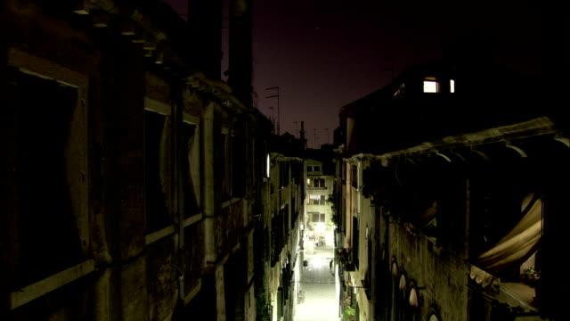 lights illuminate a ghetto alley in venice. available in hd. - ghetto video stock e b–roll
