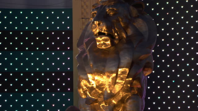 Lights illuminate a gold lion statue at the MGM Grand Hotel and Casino in Las Vegas.