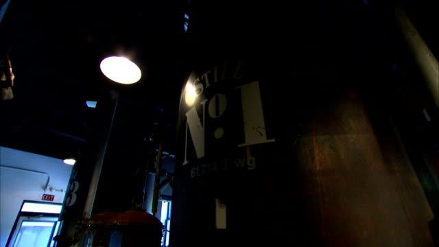 lights illuminate numbered stills. - distillery still stock videos & royalty-free footage