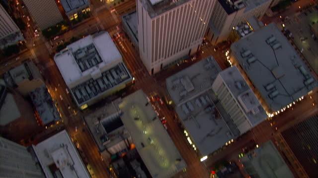 Lights illuminate  rooftops in Chicago, Illinois.