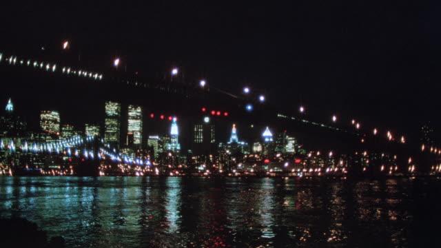 lights illuminate the brooklyn bridge and the skyline of new york city. - 1995 stock videos & royalty-free footage