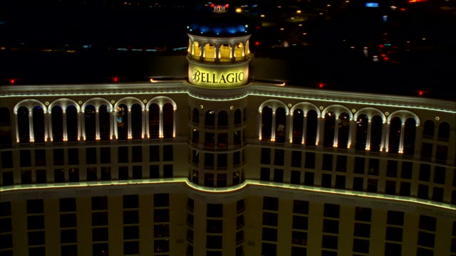 lights illuminate the dome of the bellagio hotel and casino in las vegas. available in hd. - bellagio hotel stock videos & royalty-free footage