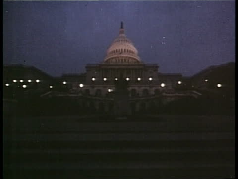 lights illuminate the dome of the us capitol building at night - congress stock videos & royalty-free footage