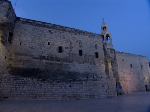 lights illuminate the exterior walls of the church of the nativity. - church of the nativity stock videos and b-roll footage