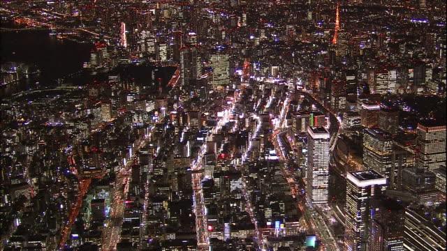 Lights illuminate the Ginza area in Tokyo at night.