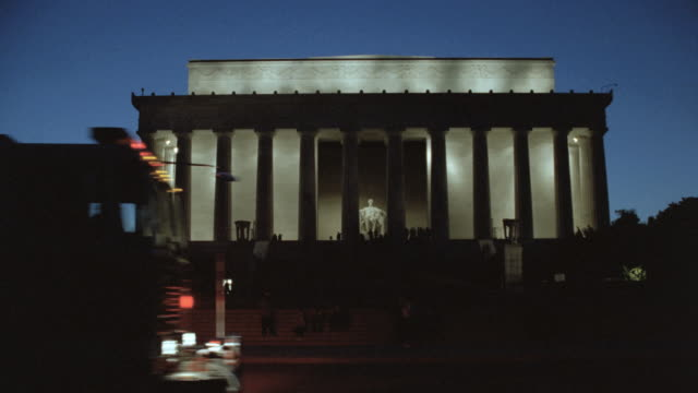 lights illuminate the lincoln memorial at night. - male likeness stock videos & royalty-free footage