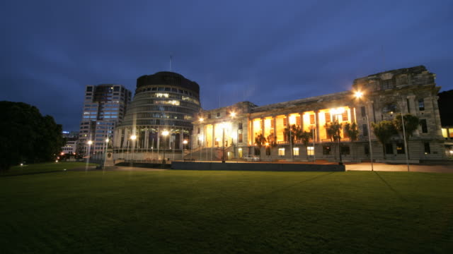 lights illuminate the new zealand parliament buildings in wellington. - beehive stock videos & royalty-free footage