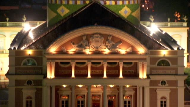 lights illuminate the ornate teatro amazonas opera house in manaus, brazil. available in hd. - manaus stock videos and b-roll footage
