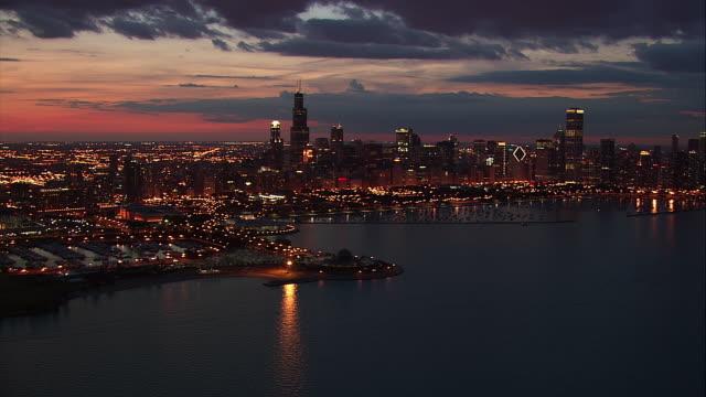 Lights illuminate the skyline of Chicago, Illinois.
