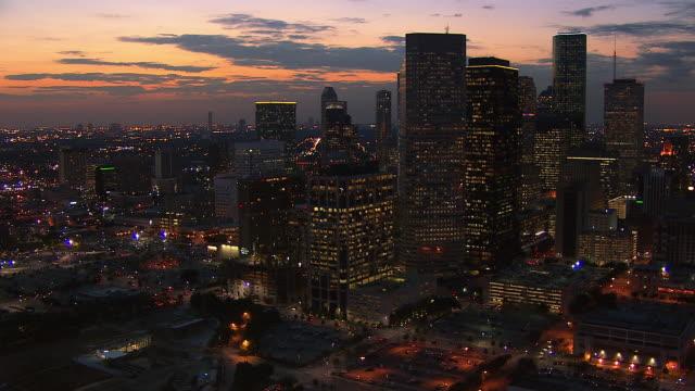 Lights illuminate the skyscrapers of the Houston skyline.