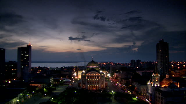 lights illuminate the teatro amazonas opera house in manaus, brazil. available in hd. - manaus stock videos and b-roll footage