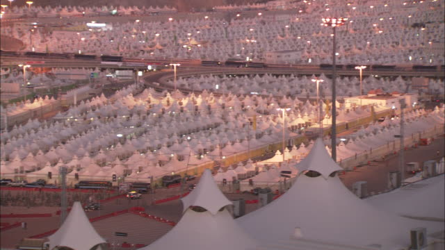 lights illuminate the tent-like structures of hajj terminal. - hajj stock-videos und b-roll-filmmaterial
