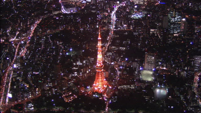 Lights illuminate the Tokyo Tower in Tokyo at night.