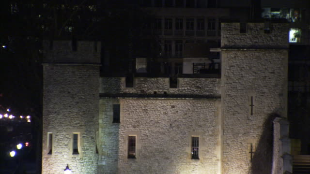 lights illuminate the tower of london at night. - tower of london stock videos and b-roll footage