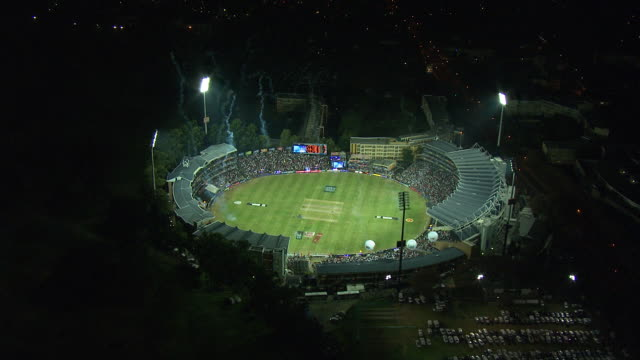 lights illuminate wanderers stadium in sandton, illovo, south africa at night. available in hd. - hd format stock videos & royalty-free footage