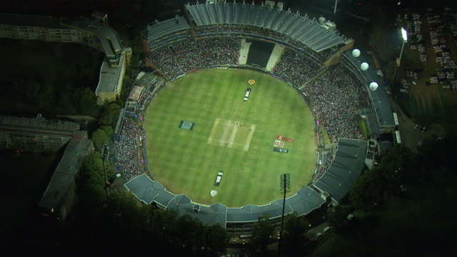 lights illuminate wanderers stadium in sandton, illovo, south africa. available in hd. - cricket video stock e b–roll