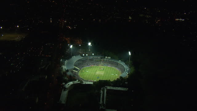 Lights illuminate Wanderers Stadium in South Africa at night. Available in HD.