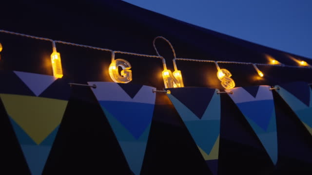 Lights in a market stall at night