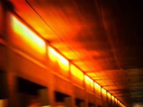 vídeos de stock, filmes e b-roll de lights lit up in a tunnel - tunnel
