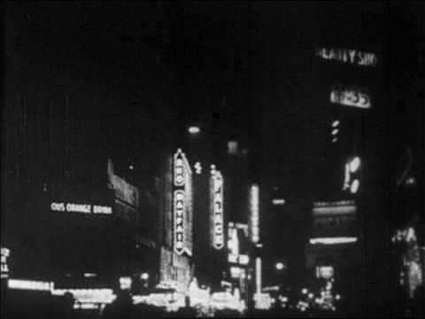 b/w 1928 lights of theatre marquees in times square at night / nyc / newsreel - 1928 stock-videos und b-roll-filmmaterial