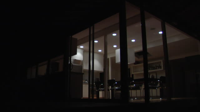 MS, Lights off and on at modem house, view through window at night, Los Angeles, California, USA