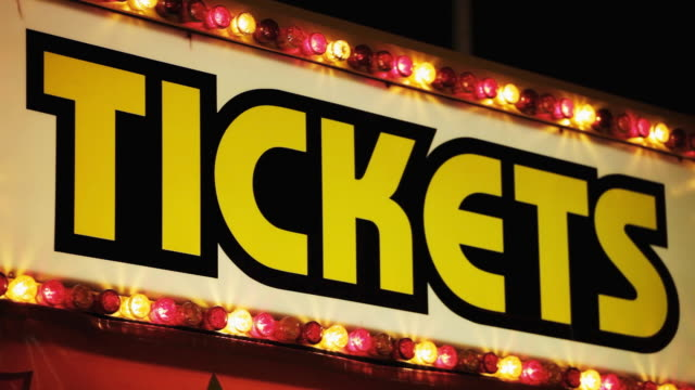 cu la lights on carnival ticket booth at night / tigard, oregon, usa - western script stock videos & royalty-free footage