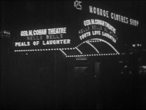 b/w 1928 lights on marquee of george m. cohan theatre at night / nyc / newsreel - 1928 stock-videos und b-roll-filmmaterial