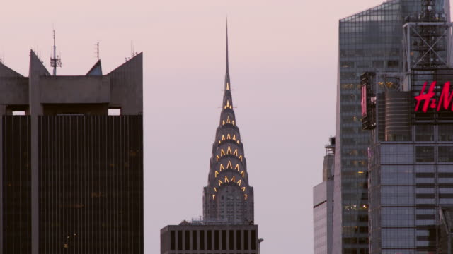 Lights on top of Chrysler Building shut off as a new day begins.