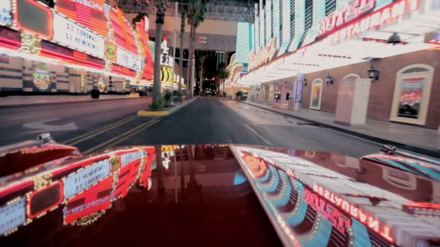 Lights reflect off a car as it travels along The Strip in Las Vegas.