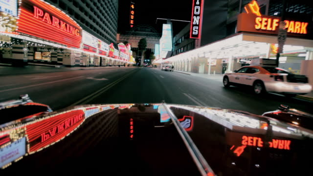 lights reflect off a car as it travels along the strip in las vegas. - the strip las vegas stock-videos und b-roll-filmmaterial