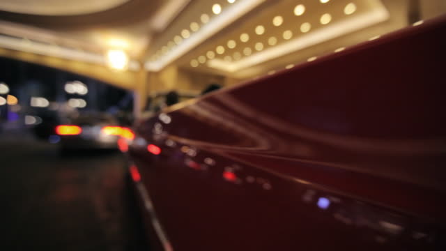 lights reflect off a red convertible in the palazzo hotel in las vegas. - the palazzo las vegas stock videos & royalty-free footage