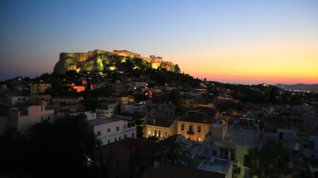 lights shine at the acropolis hill as seen from a rooftop at dusk on august 23, 2020 in athens. during the coronavirus pandemic, greece is... - athens greece stock videos & royalty-free footage