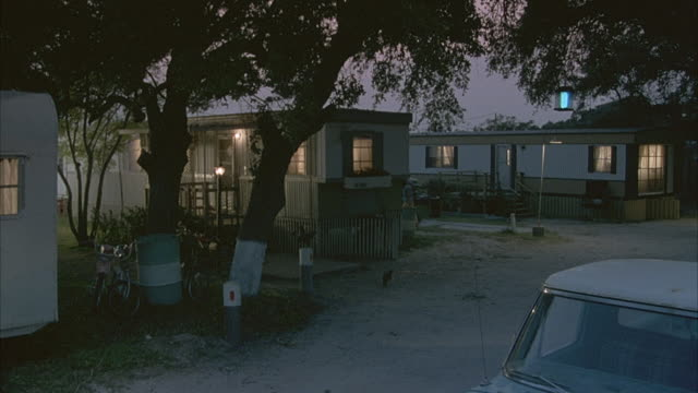 lights shine from the homes in a trailer park in texas. - trailer home stock videos & royalty-free footage