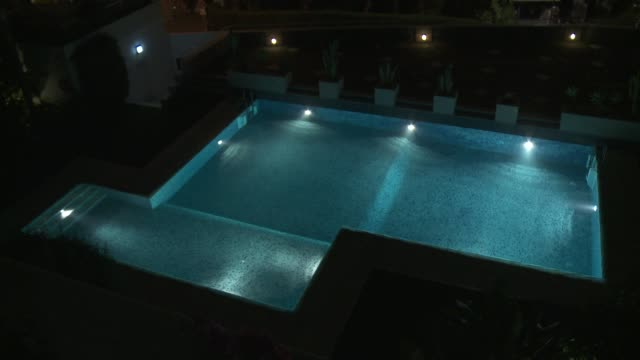Lights shine on a swimming pool in Marbella.