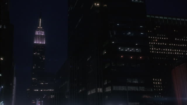 Lights shine on the Empire State Building at night.