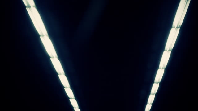 lights shine on the roof of a tunnel in hong kong. - neon stock videos & royalty-free footage