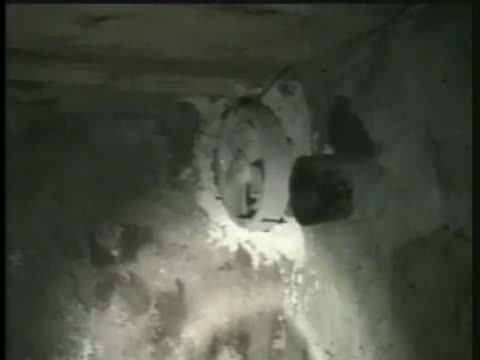 lights shine on the walls of the hole where saddam hussein was captured. - hole stock videos & royalty-free footage