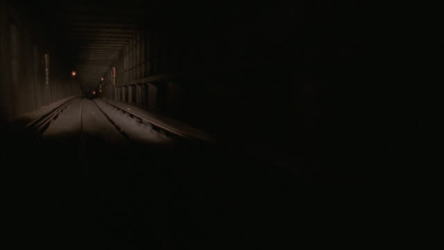 lights shine on tracks in a subway tunnel. - railroad track stock videos & royalty-free footage