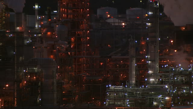 lights sparkle on an oil refinery at night. - refinery stock videos & royalty-free footage