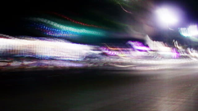 lights streak down a city street. - digital enhancement stock videos & royalty-free footage
