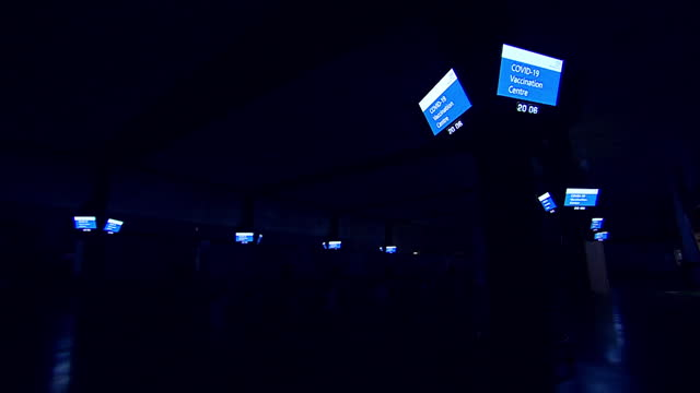 lights turning off at the end of the day at mass covid-19 vaccination centre at epsom racecourse - turning stock videos & royalty-free footage