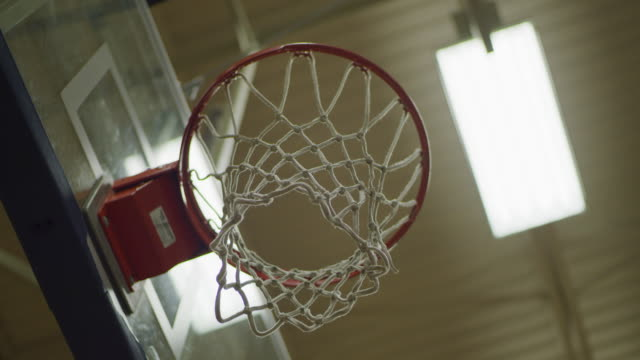 lights turning off in school gym with basketball hoop - secondary school stock videos & royalty-free footage