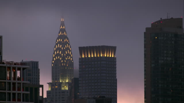 lights turning off in the chrysler building in manhattan - international landmark stock videos & royalty-free footage