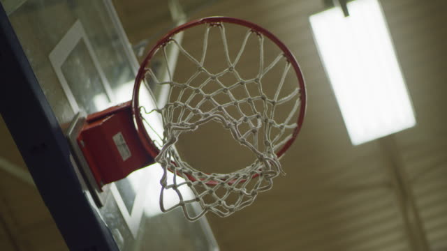 lights turning on in school gym revealing basketball hoop - sports court stock videos & royalty-free footage