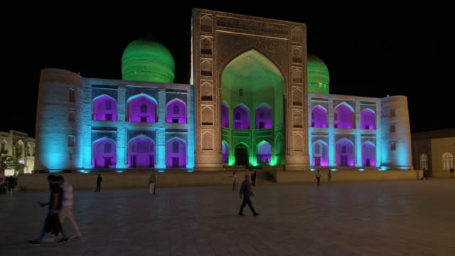 lightshow on colorful illuminated ensemble of mir-i arab-madressa kalyan-mosque and minaret - bukhara stock videos & royalty-free footage